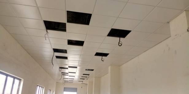 Metal false ceiling lay in tile