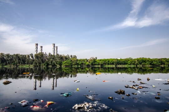 A water body is seen polluted by industrial waste