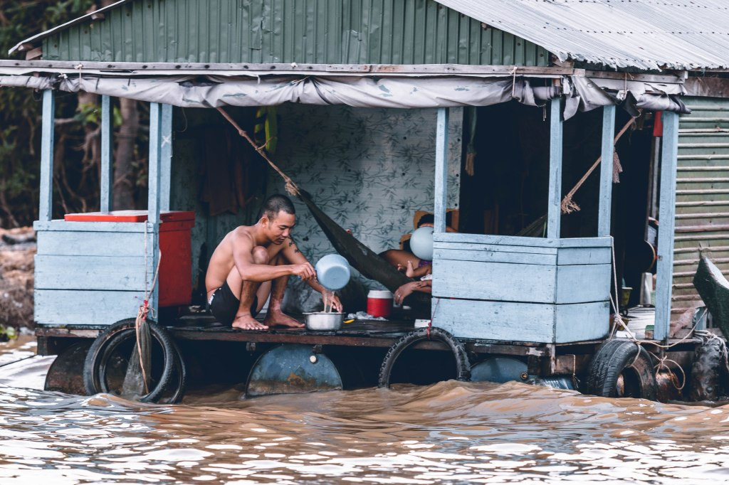 A family isolated in a building due to flood which shows why flood management is important